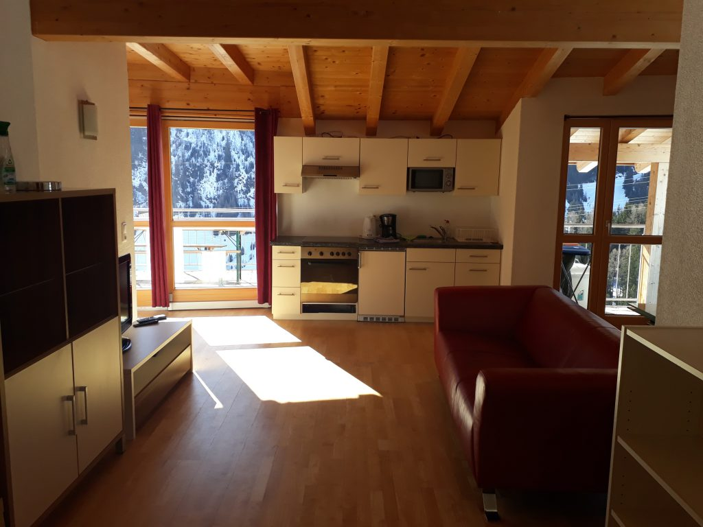 Living area in 1 bedroom ski in / out apartment in St.Anton
