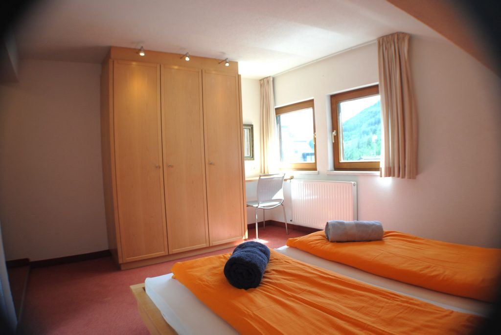 Austrian twin room in Chalet Scherl